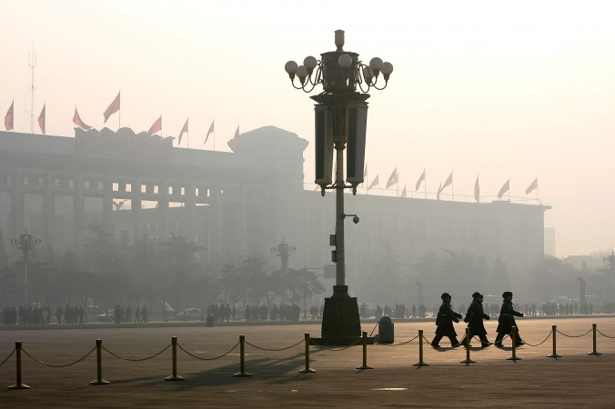 BEIJING - JANUARY 01: Chinese police officers patrol Tiananmen Square during fog on January 1, 2005 in Beijing, China. According to a recent survey, Beijing does not rank in China's top 10 cities in terms of suitability for living such as its bad traffic, high housing prices and heavy pollution, China Daily said. (Photo by Cancan Chu/Getty Images)