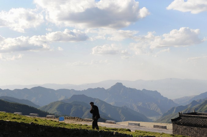 A man walks on Yedou Peak, the highest of Mount Wutai's five peaks at 3058 metres and known as the roof of northern China on June 24, 2009 in Shanxi province. Officials are banned from meeting at such scenic sites, according to a new directive by anti-corruption authorities. (Frederic  J. Brown/AFP/Getty Images)