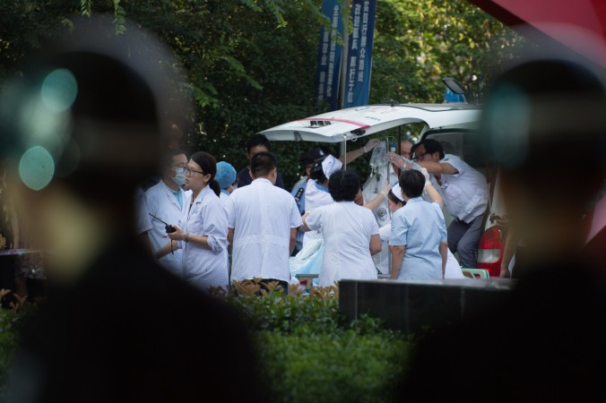 In this file photo, doctors and nurses rush a victim of a factory explosion for treatment at a hospital in China, on August 2, 2014. (Johannes  EiseleE/AFP/Getty Images)