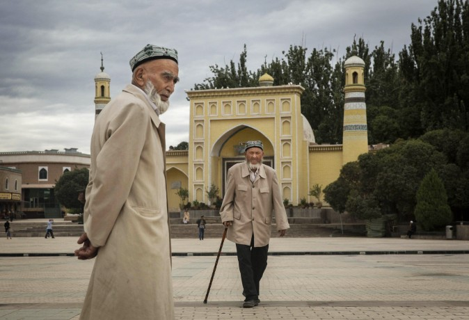 Uyghur men walk in front of the Id Kah Mosque, China's largest mosque, on July 31, 2014 in Kashgar, Xinjiang Uyghur Autonomous Region, China. (Getty Images/Getty Images)
