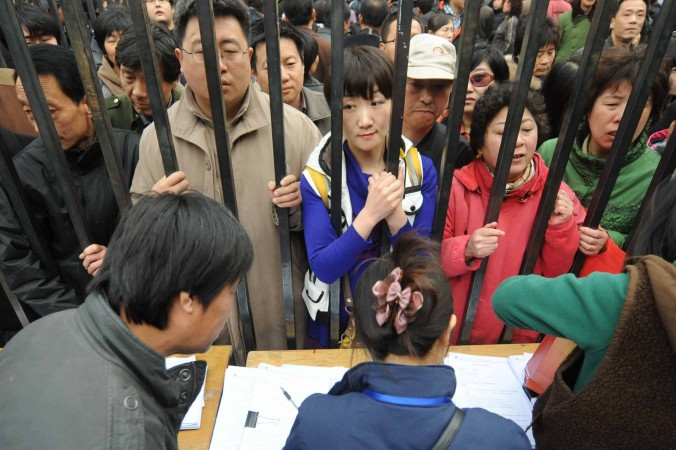 People queue to get better numbers on a waiting list for new apartments after the local government announced the demolition of an old central part of Tongzhou, in the western suburbs of Beijing on April 8, 2010. (STR/AFP/Getty Images)