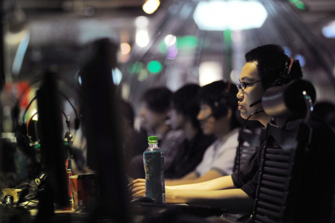 This photo taken on May 12, 2011 shows people at an internet cafe in Beijing. China. (Gou Yige/AFP/Getty Images)