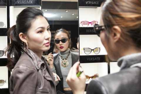Two Chinese women shop for sunglasses at the Versace store on 5th Avenue in New York City on April 3, 2014. (Samira Bouaou/Epoch Times)