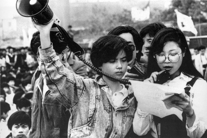 A Student from a college radio station, reads comments of pro-democracy supporters on Tiananmen Square in Beijing in May 1989. (Courtesy of 64Memo.com)