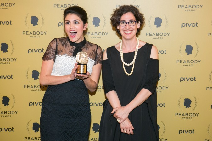Sarah Koenig (R) and Cecily Strong, hold their award at the 74th Peabody Award at the Cipriani Wall Street in Manhattan on May 31, 2015. (Benjamin Chasteen/Epoch Times)