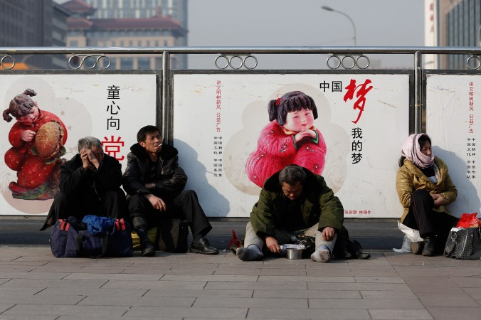 A beggar at the Beijing Railway Station on March 2, 2014, in Beijing.  Developed economies are based on a broad middle class—precisely what has not been attained in China. (Lintao Zhang/Getty Images)