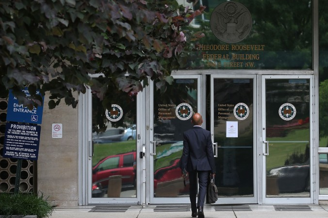 The entrance to the Theodore Roosevelt Federal Building that houses the Office of Personnel Management headquarters is shown June 5 in Washington. The departments networks were breached by hackers who stole information on four million U.S. government employees. (Mark Wilson/Getty Images)