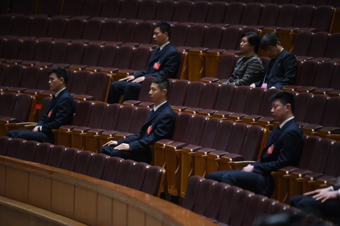 Security guards watch the closing ceremony of the Chinese People's Political Consultative Conference, an advisory body to the legislature, the National People's Congress (NPC), in Beijing's Great Hall of the People on March 13, 2015. (Greg Baker/AFP/Getty Images)