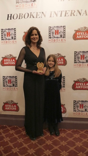 Kay Rubacek with her daughter pose for a photo after Hard to Believe won an award for best documentary at the 2016 Hoboken International Film Festival. (Image supplied)