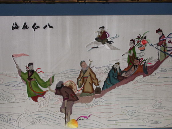 This needlepoint depicts the Eight Immortals as they crossed the ocean on the way to the Conference of the Magical Peach.