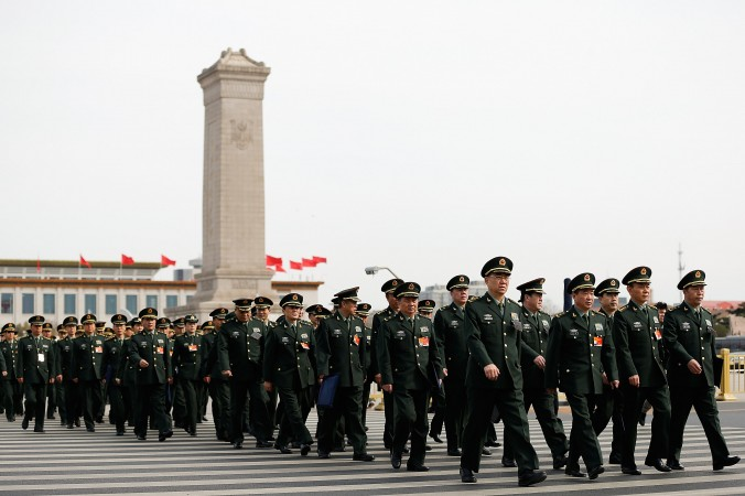 "Delegates from Chinese regime's military attend its National People's Congress on March 8 in Beijing, China. The Chinese regime released its new military strategy, which calls for ""active defense."" (Lintao Zhang/Getty Images)"