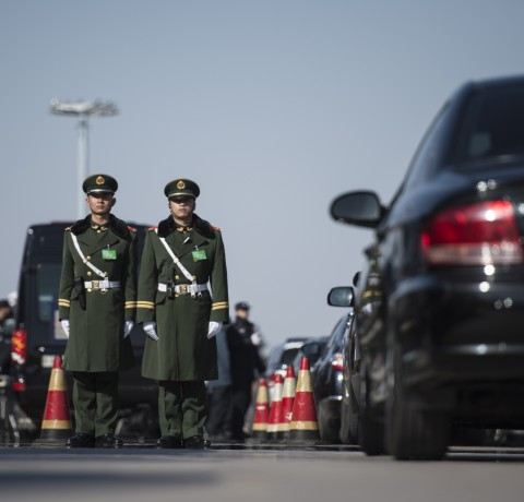 Paramilitary police officers stand guard during the opening session of the Chinese People's Political Consultative Conference (CPPCC) at the Great Hall of the People in Beijing on March 3, 2015. (FRED DUFOUR/AFP/Getty Images)