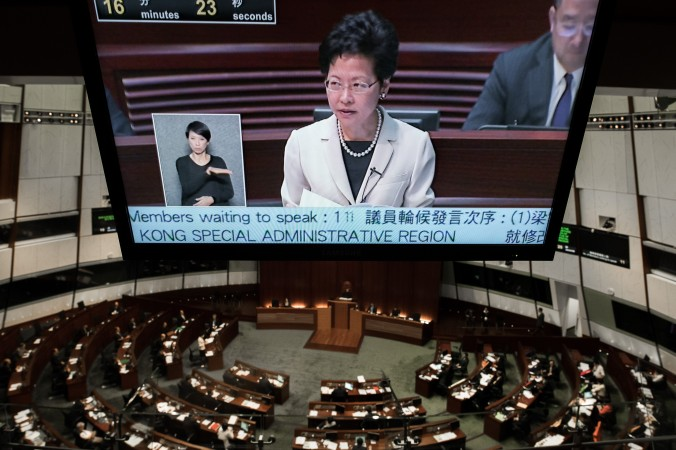 A TV screen shows Hong Kong Chief Secretary Carrie Lam as she addresses the city's legislature in Hong Kong on June 17, 2015. (Philippe Lopez/AFP/Getty Images)