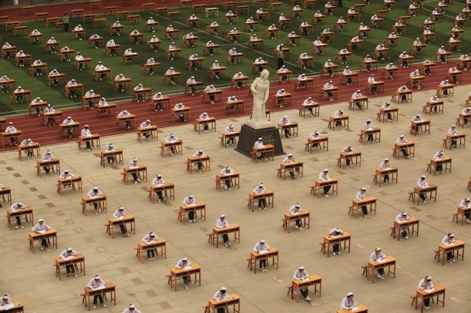 Students from College of Nursing in a vocational school take part in graduation examination outside classroom on May 25, 2015 in Baoji, Shaanxi province of China. (ChinaFotoPress/ChinaFotoPress via Getty