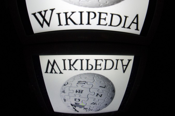 "In this file photo, yhe ""Wikipedia"" logo is seen on a tablet screen on December 4, 2012 in Paris. (Lionel Bonaventure/AFP/Getty Images)"