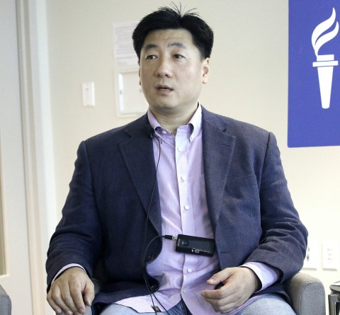 Bao Pu, political commentator, human rights activist, and founder of New Century Press in Hong Kong, publishes books that have been banned in China. He spoke May 28 at Freedom House, on
