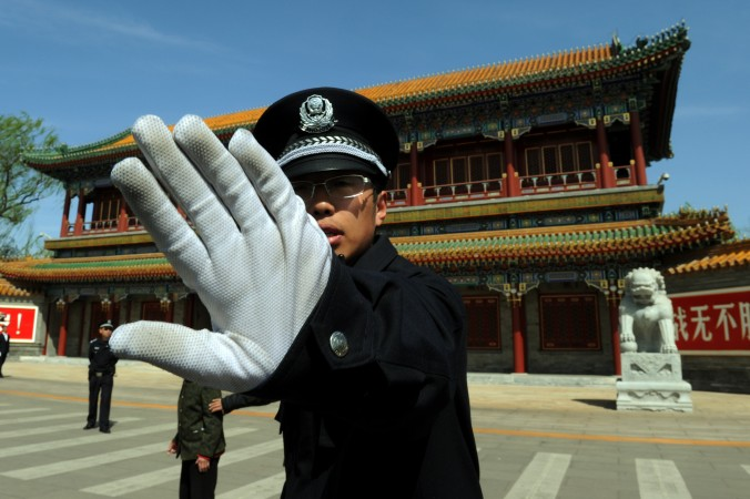 A Chinese policeman blocks photos being taken outside Zhongnanhai which serves as the central headquarters for the Communist Party of China after the sacking of politician Bo Xilai from the countries powerful Politburo, in Beijing on April 11, 2012.  (MARK RALSTON/AFP/Getty Images)